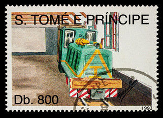 Small diesel locomotive in depot on postage stamp