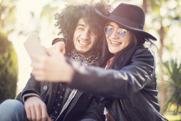 Couple having fun and takes selfie photo themself