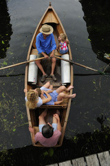 Family in rowing boat, top view