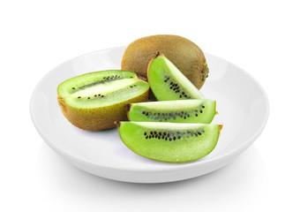 Juicy kiwi fruit in plate on white background