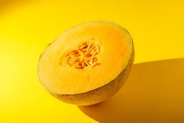 Cantaloupe on yellow background