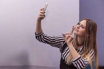 Young woman taking a selfie. Millenial. Copy space.