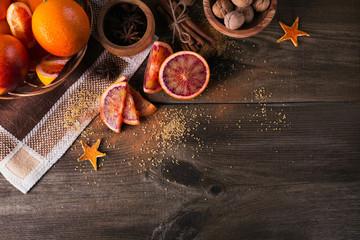 Fresh red orange fruit, anise, cinnamon and walnuts