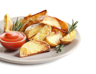 Plate with tasty potato wedges and tomato sauce on white background