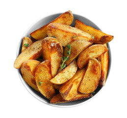 Bowl with tasty potato wedges on white background