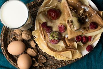 delicious pancakes with milk, eggs