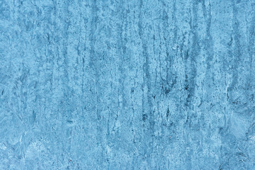 Frozen glass, ice texture on window, natural background. Abstract wallpaper