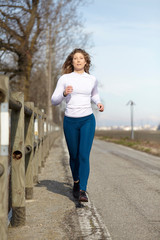 woman running in fall winter season