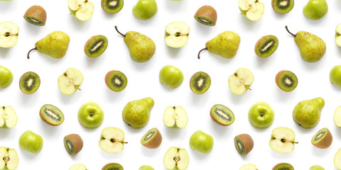 Fototapete - Seamless pattern of fresh fruits. Pears, apples, slices of  kiwi isolated on white background, top view, flat layout. Food texture. The concept of healthy eating.