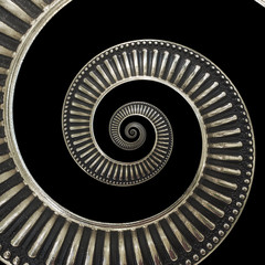 Isolated on black metal abstract spiral background pattern fractal. Metallic background, repetitive pattern. Metal spiral decorative element. Twisted distorted metal staircase background fractal
