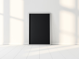Black picture Poster Frame standing on the white floor. 3d rendering