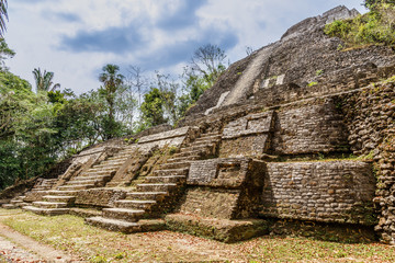 Central ancient pyramid of old Mayan civilization city,  Lamanai archeological site, Orange Walk District, Belize