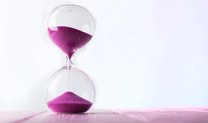 Hourglass with pink sand. Wall mural