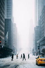 People walking on city street in winter