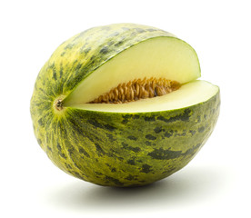 One melon Piel de Sapo cut open (Santa Claus Christmas variety) isolated on white background green striped outer rind with seeds.