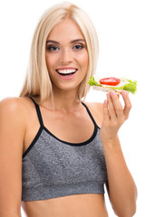 Woman in sportswear with vegetarian sandwich, isolated