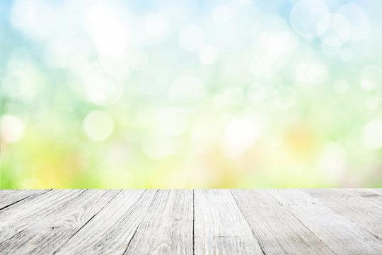 Wooden deck with blurred flower garden background