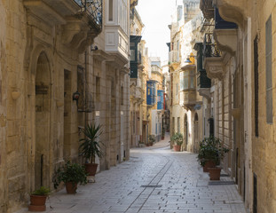 Foto op Canvas Barcelona Empty street between traditional houses in the city of Vittoriosa, Three Cities, Malta