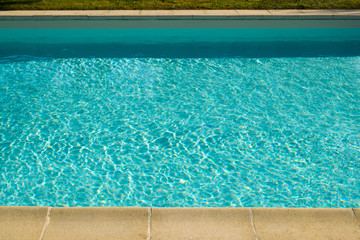 Textured light effect on the surface ripples of an outdoor swimming pool