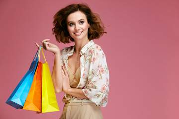 Fashion. Woman With Shopping Bags