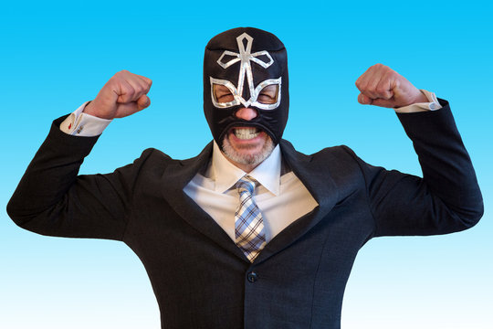 businessman with wrestler mask and fighting position