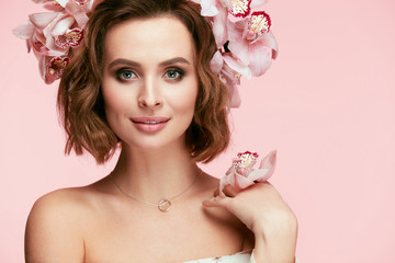 Fashion Makeup. Woman With Flowers In Hair In Spring