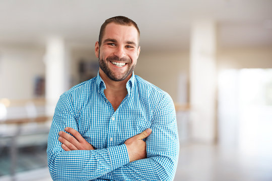 Smiling man standing in business center