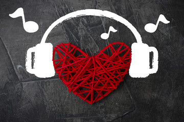 Heart in headphones on a dark background. Theme for Valentine's Day. Wedding, love 1