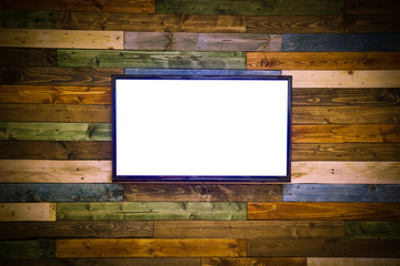 Blank lcd Flat screen television hanging at the planks wooden wall with copy space in living room or bedroom on color wooden wall