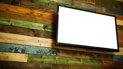 Plasma TV on the wooden wall of the room,Plasma TV hanging on wall.