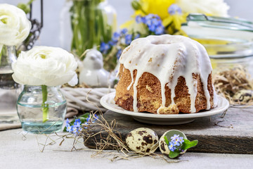 Traditional easter cake and seasonal table decorations.