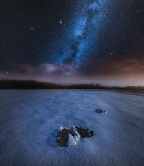 Night landscape with molehill under starry beautiful sky
