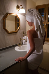 girl in the Bathrobe in the bathroom standing