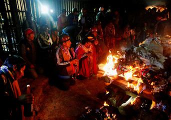 Independent miners attend a ceremony to bless the mine by offering animal sacrifice as part of Andean carnival celebrations, outside the Mina Itos on the outskirts of Oruro