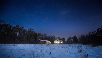 Calm night in polish countryside. House near forest