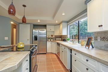 Second floor Kitchen boasts tray ceiling, island