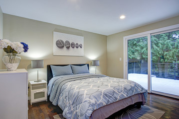 Second floor bedroom with taupe walls, blue bed