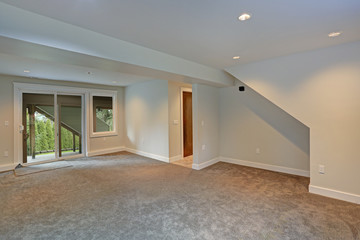 Fully renovated living area with glass doors to the backyard