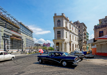 Cuban classic car turning onto Paseo del Prado