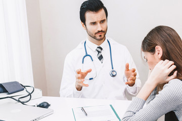 Doctor and woman patient consulting on doctors table in hospital.healthcare and medicine