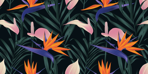Seamless pattern, tropical plants, Bird of paradise flower, pink Anthurium and palm leaves on black background