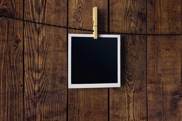 Empty picture on wooden background