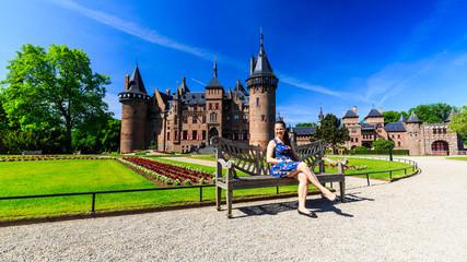 View of a tourist girl in the gardens of the De Haar Castle