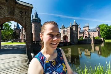 Girl in the park of De Haar Castle in Netherlands