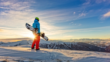 Snowboarder on the top of mountain, Alpine scenery