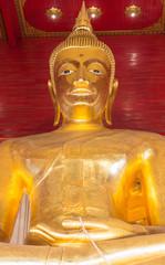 Big gold buddha statue . close up . Wat Mong khon Bophit temple . symbol of landmark Ayutthaya Thailand place .