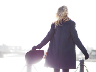 Young woman in coat outside