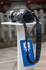 a public stand for camera beside the landmark at Tokyo city. Camera stand for photographer in city. Camera on the public solid monopod ready for make selfie photo.