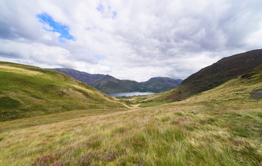 Views of Crummock Water, Grasmoor and Robinson from Floutern Cop in the English Lake District, UK.