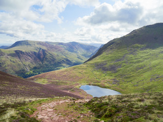 Views of Buttermere & Bleaberry Tarn on route to the summit of Red Pike with Wandope, Robinson, Dale Head and Fleetwith Pike in the distance. The English Lake District, UK.